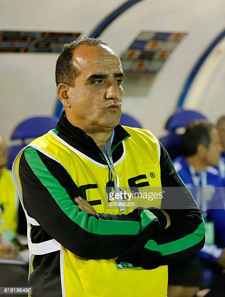 Bejaia's coach Nasser Sandjak looks at his players during the CAF Confederation cup final Algerian Mouloudia Bejaia against Congolese TP Mazembe on...
