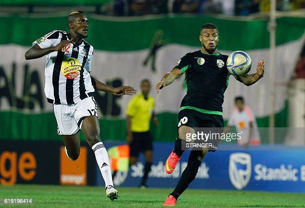 Bejaia's Merveille Bope vies with Mazembe's Morgan Betorangal during the CAF Confederation cup final Algerian Mouloudia Bejaia against Congolese TP...
