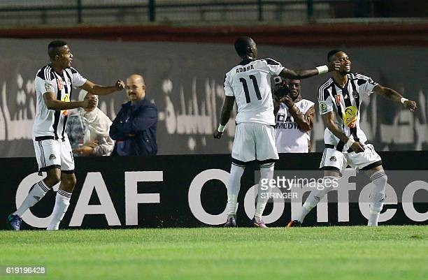 Bejaia's players Roger Claver Assale and Adama Traore celebrate after their team scored during the CAF Confederation cup final Algerian Mouloudia...