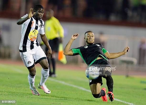 Bejaia's Roger Claver Assale vies with Mazembe's Morgan Betorangal during the CAF Confederation cup final Algerian Mouloudia Bejaia against Congolese...