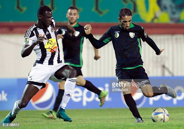 Bejaia's Salif Coulibaly vies with Mazembe's Faouzi Rahal during the CAF Confederation cup final Algerian Mouloudia Bejaia against Congolese TP...