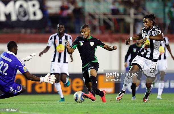 Bejaia's Sylvain Gbohouo vies with Mazembe's Morgan Betorangal and Christian Luyindama Nekadio during the CAF Confederation cup final Algerian...