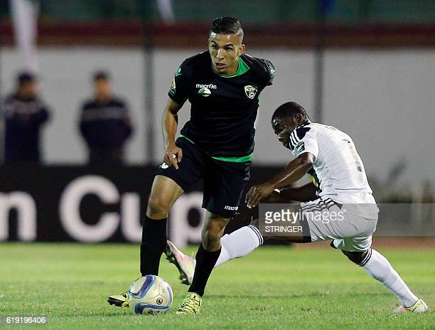 Bejaia's Yacine Salhi vies with Mazembe's Morgan Betorangal during the CAF Confederation cup final Algerian Mouloudia Bejaia against Congolese TP...