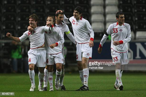 Beka Gotsiridze of Georgia celebrates with team mates after scoring their second goal during the International Friendly match between Wales and...
