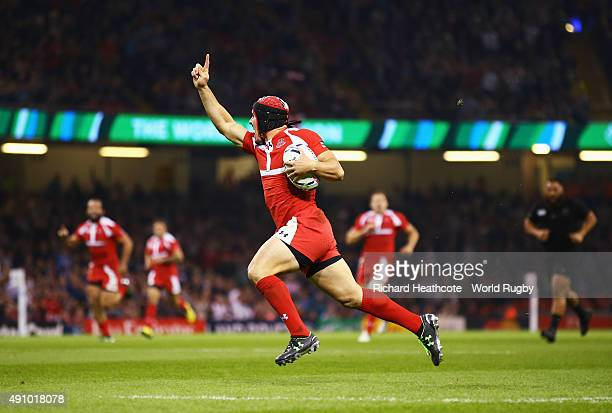 Beka Tsiklauri of Georgia celebrates as he runs in to score their first try during the 2015 Rugby World Cup Pool C match between New Zealand and...