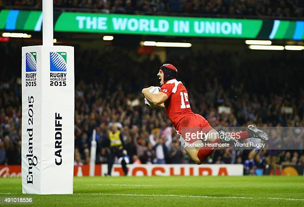 Beka Tsiklauri of Georgia goes over to score their first try during the 2015 Rugby World Cup Pool C match between New Zealand and Georgia at the...
