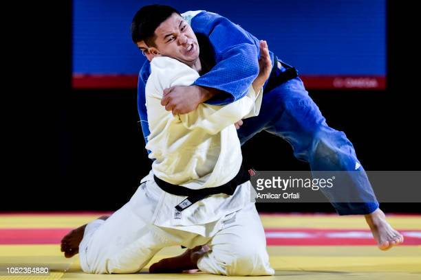 Bekarys Saduakas of Kazakhstan competes against Ilia Sulamanidze of Georgia in the Men's 100 kg Final during Buenos Aires 2018 Youth Olympics at...