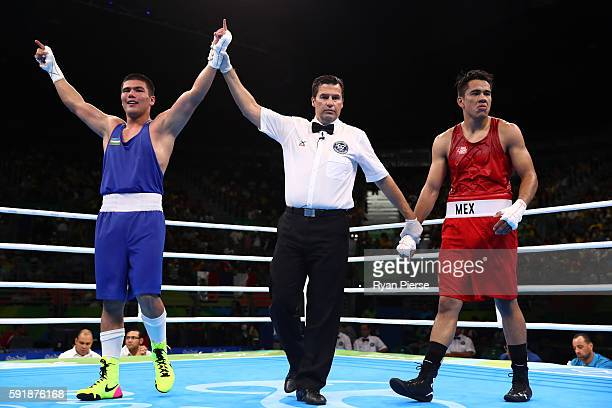 Bektemir Melikuziev of Uzbekistan celebrates after defeating Misael Uziel Rodriguez of Mexico during a Men's Middle Semifinal bout on Day 13 of the...