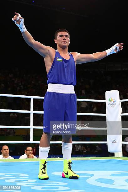 Bektemir Melikuziev of Uzbekistan celebrates after defeating Misael Uziel Rodriguez of Mexico in a Men's Middle Semifinal bout on Day 13 of the 2016...