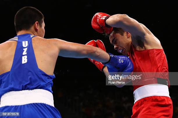Bektemir Melikuziev of Uzbekistan fights against Misael Uziel Rodriguez of Mexico during a Men's Middle Semifinal bout on Day 13 of the 2016 Rio...