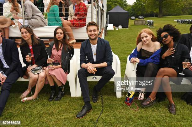 Bel Powley Douglas Booth and Ellie Bamber attend the Audi Polo Challenge at Coworth Park on May 6 2017 in Ascot United Kingdom