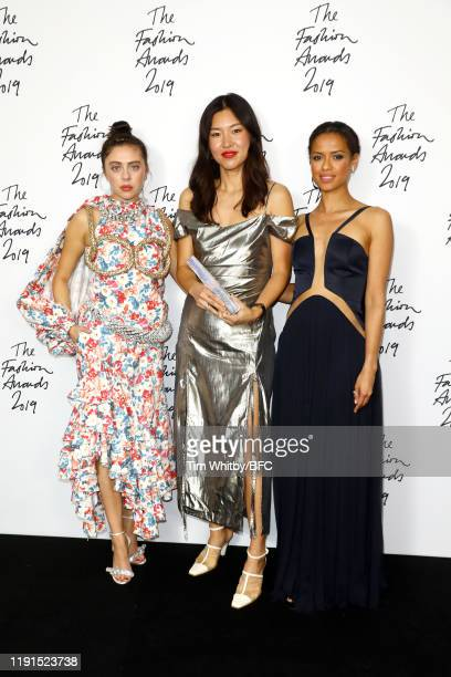 Bel Powley Rejina Pyo winner of the British Emerging Talent Womenswear award and Gugu MbathaRaw in the winners room during The Fashion Awards 2019...