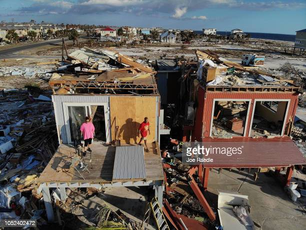 Bela and Jaques Sebastiao begin the process of cleaning up their home after after it was heavily damaged by Hurricane Michael on October 17 2018 in...