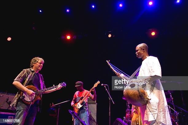 Bela Fleck Seckou Bah and 'Benogo' Diakite perform on stage at the Queen Elizabeth Hall on July 18 2012 in London United Kingdom