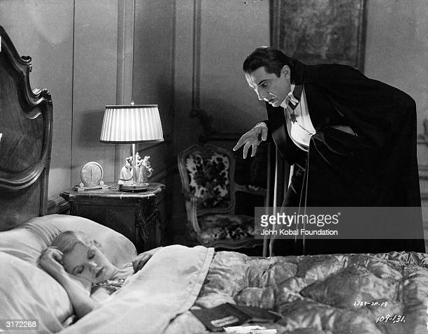 Bela Lugosi creeps up on the sleeping Lucy Weston played by Frances Dade in 'Dracula' directed by Tod Browning