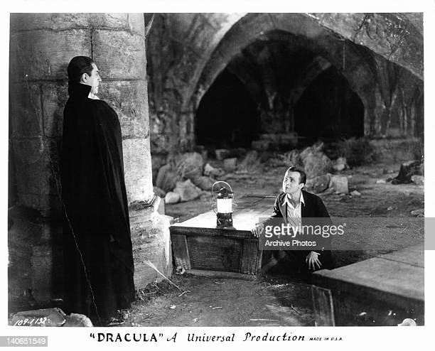 Bela Lugosi looking down upon David Manners in a scene from the film 'Dracula' 1931