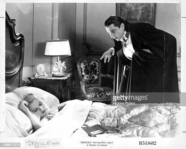 Bela Lugosi stalks a woman sleeping in a scene from the film 'Dracula' 1931