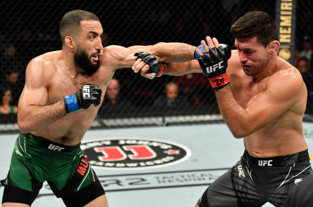 Belal Muhammad punches Demian Maia of Brazil in their welterweight fight during the UFC 263 event at Gila River Arena on June 12, 2021 in Glendale,...