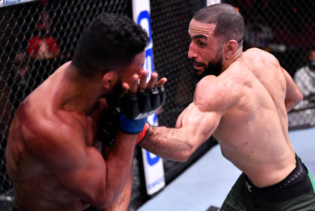 Belal Muhammad punches Dhiego Lima of Brazil in their welterweight fight during the UFC 258 event at UFC APEX on February 13, 2021 in Las Vegas,...