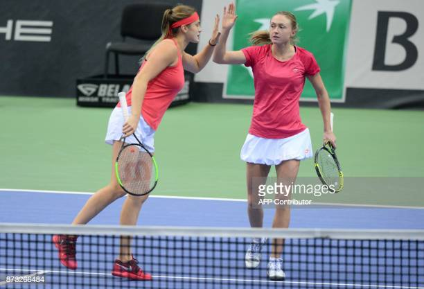 Belarus' Aliaksandra Sasnovich and Aryna Sabalenka react on November 12 2017 in Minsk during their match against US Shelby Rogers and Coco Vandeweghe...