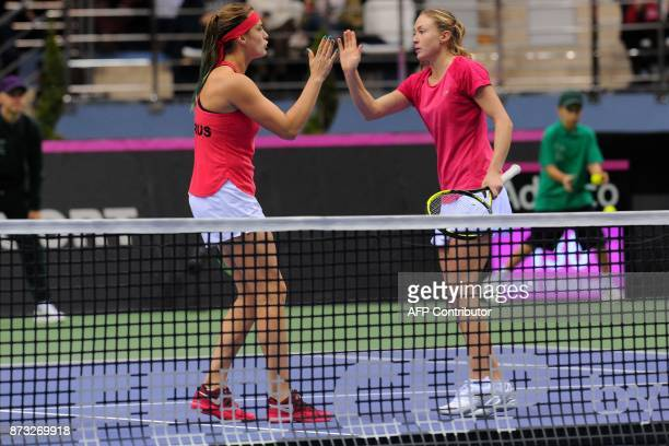 Belarus' Aliaksandra Sasnovich and Aryna Sabalenka react on November 12 2017 in Minsk during their match against USA's Shelby Rogers and Coco...