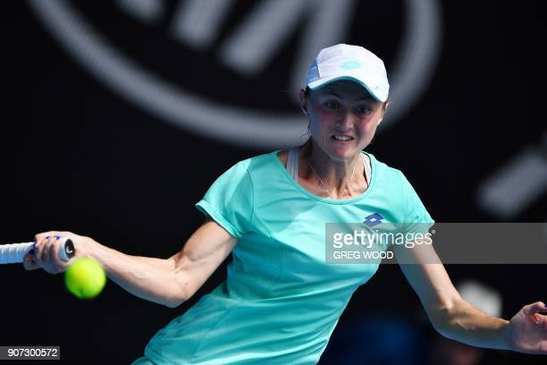 Belarus' Aliaksandra Sasnovich hits a return against France's Caroline Garcia during their women's singles third round match on day six of the...