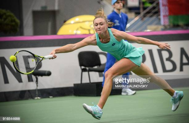 Belarus' Aliaksandra Sasnovich hits a return to Germany's Antonia Lottner during the Fed Cup tennis world group first round match between Belarus and...