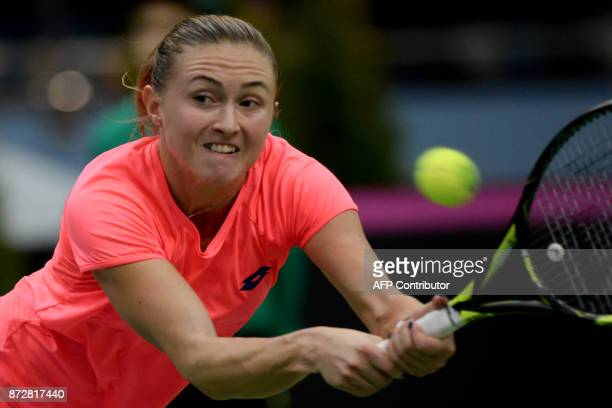 Belarus' Aliaksandra Sasnovich returns the ball to US Coco Vandeweghe on November 11 2017 in Minsk during their Fed Cup final tennis match between...