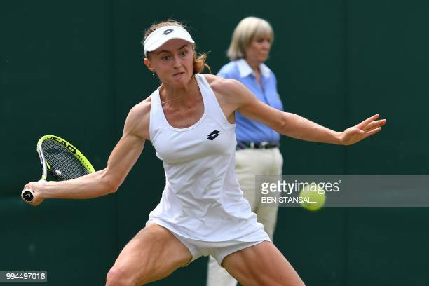 Belarus' Aliaksandra Sasnovich returns to Latvia's Jelena Ostapenko in their women's singles fourth round match on the seventh day of the 2018...