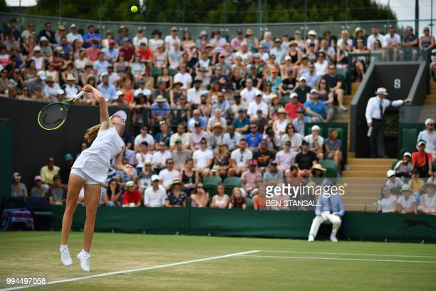 Belarus' Aliaksandra Sasnovich serves to Latvia's Jelena Ostapenko in their women's singles fourth round match on the seventh day of the 2018...