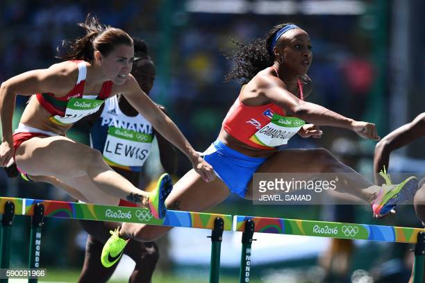Belarus' Alina Talay and Puerto Rico's Jasmine CamachoQuinn compete in the Women's 100m Hurdles Round 1 during the athletics event at the Rio 2016...