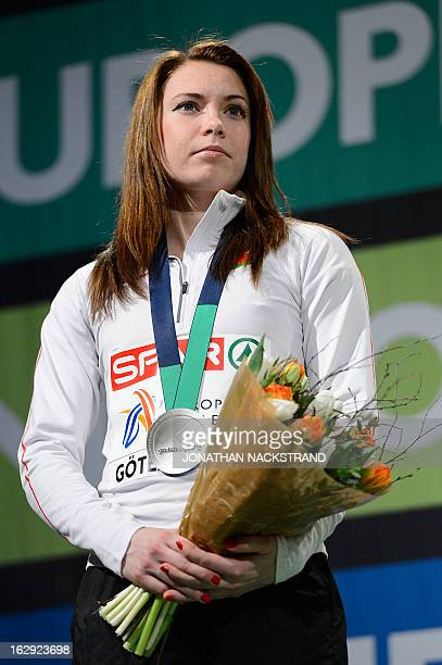 Belarus' Alina Talay celebrates with her silver medal on the podium after the women's 60m Hurdles Final event at the European Indoor athletics...