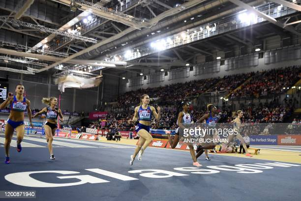 Belarus' Alina Talay competes take first place ahead of third placed US Christina Clemons and second placed US Nia Ali in the women's 60m hurdles...