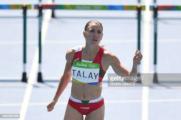 Belarus' Alina Talay reacts after competing in the Women's 100m Hurdles Round 1 during the athletics event at the Rio 2016 Olympic Games at the...