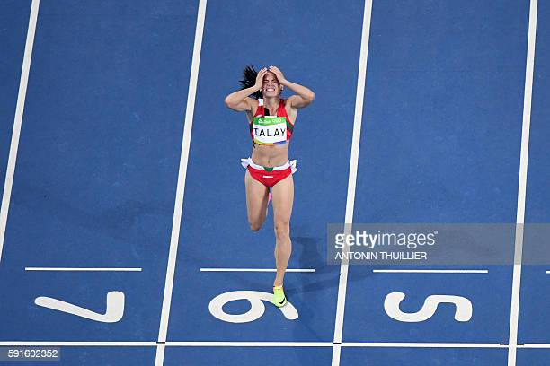 Belarus' Alina Talay reacts as she crosses the finish line in the Women's 100m Hurdles Semifinal during the athletics event at the Rio 2016 Olympic...