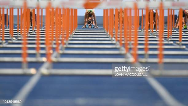 Belarus' Alina Talay takes the start in the women's 100m Hurdles semifinal race during the European Athletics Championships at the Olympic stadium in...