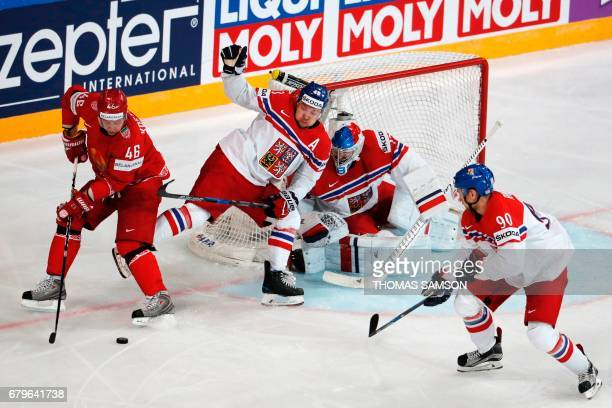 Belarus' Andrei Kostitsyn controls the puck during the IIHF Men's World Championship group B ice hockey match between Belarus and Czech Republic in...