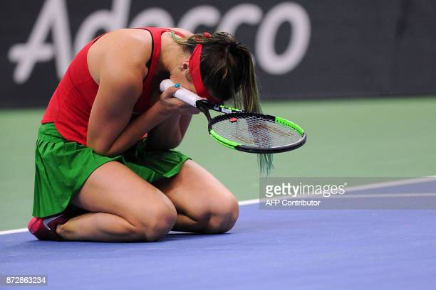 Belarus' Aryna Sabalenka celebrates after defeating US Sloane Stephens on November 11 2017 in Minsk during their Fed Cup final tennis match between...