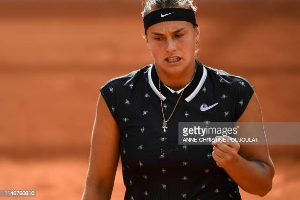 Belarus' Aryna Sabalenka celebrates after scoring a point against Slovakia's Dominika Cibulkova during their women's singles first round match on day...