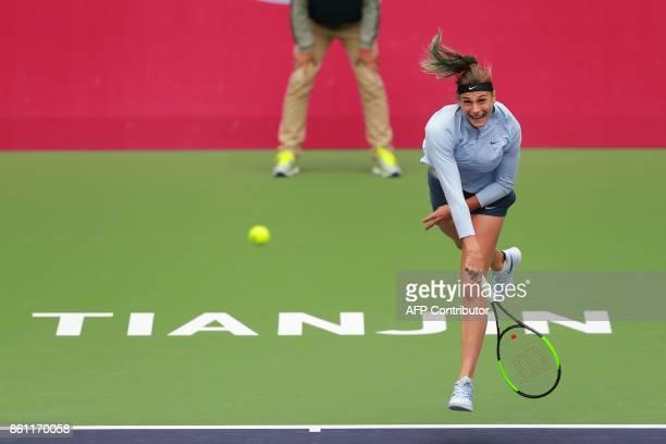 Belarus' Aryna Sabalenka hits a return against Italy's Sara Errani during their women's singles semifinal match at the WTA Tianjin Open tennis...