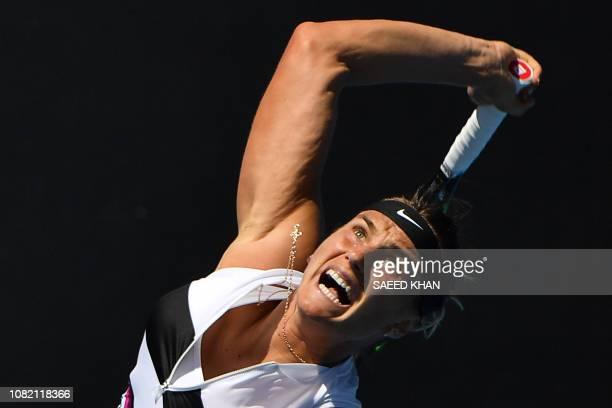 Belarus' Aryna Sabalenka hits a return against Russia's Anna Kalinskaya on day one of the Australian Open tennis tournament in Melbourne on January...
