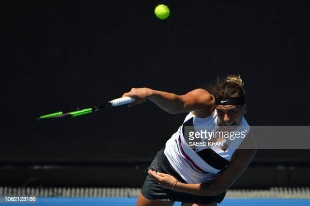 Belarus' Aryna Sabalenka hits a return against Russia's Anna Kalinskaya during their women's singles match on day one of the Australian Open tennis...