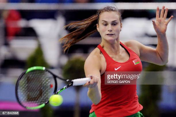 Belarus' Aryna Sabalenka hits a return to Switzerland's Viktorija Golubic during the semifinals of the Fed Cup tennis competition between Belarus and...