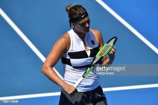 Belarus' Aryna Sabalenka looks at her racquet during her match against Russia's Anna Kalinskaya on day one of the Australian Open tennis tournament...