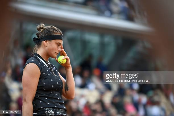 Belarus' Aryna Sabalenka reacts as she plays against Slovakia's Dominika Cibulkova during their women's singles first round match on day three of The...