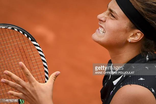 TOPSHOT Belarus' Aryna Sabalenka reacts as she plays against Slovakia's Dominika Cibulkova during their women's singles first round match on day...