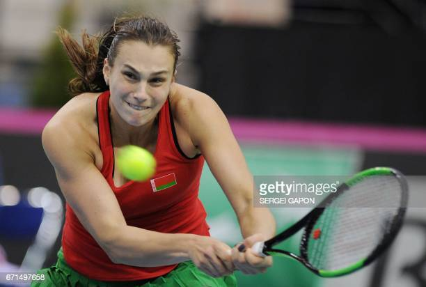 Belarus' Aryna Sabalenka returns the ball to Switzerland's Timea Bacsinszky during the semifinals of the Fed Cup tennis competition between Belarus...