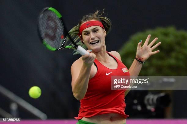 Belarus' Aryna Sabalenka returns the ball to US Sloane Stephens on November 11 2017 in Minsk during their Fed Cup final tennis match between Belarus...