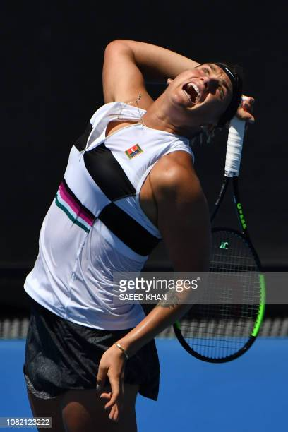 Belarus' Aryna Sabalenka serves against Russia's Anna Kalinskaya during their women's singles match on day one of the Australian Open tennis...