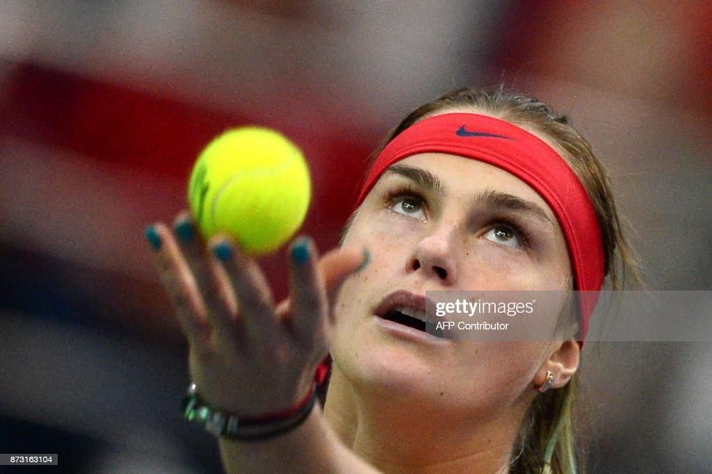Belarus' Aryna Sabalenka serves the ball to USA's Coco Vandeweghe, on November 12, 2017 in Minsk, during their Fed Cup final tennis match between Belarus and the United States. /